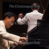 """Solo pianist Jon Nakamatsu plays Tchaikovsky's """"Piano Concerto No. 1 in B-flat minor, op. 23"""" during the Into the Music Series No. 2: """"Total Tchaikovsky"""" concert on Tuesday, July 26, 2016, in the Amphitheater. Photo by Carolyn Brown."""
