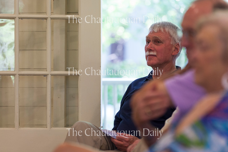 Greg Prechtl listens to speakers, including Tom Becker and Sebby Baggiano, pay tribute to his thirty years of leadership at the Boys' and Girls' Club on June 25, 2016, inside Girls' Club. One speaker was Ryan Murphy, daughter of George Murphy, vice president and chief marketing officer of Chautauqua, who teared up when explaining what her experiences with Prechtl have meant to her and her sisters in their experiences as Club counselors.