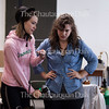 "Actresses Allison Altman, left, and Kathryn Metzger, right, as Sabrina Daldry and Catherine Givings, respectively, rehearse a scene from the Chautauqua Theater Company's upcoming production of Sarah Ruhl's ""In the Next Room (or the vibrator play),"" directed by Larissa Kokernot, in Brawdy Theater Studios on June 25, 2016. <br /> <br /> In the show, the two actresses play women in the Victorian era who rediscover their own sexuality when Givings's husband introduces them to a mechanism that we know today as a vibrator. In this scene, the two women have their first experience with the vibrator without their husbands.<br /> <br /> Photo by Carolyn Brown."