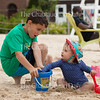 """Jayden Greening, left, eight, plays with his cousin Iona Morris, fifteen months, right, while he builds a sandcastle at Children's Beach on June 29, 2016. Greening and his family are from California, but Morris and her family live in London. <br /> <br /> Mollie Worth, Morris's mother, who was visiting Children's Beach with her daughter, said that she prefers the culture, geography, and climate of Chautauqua to those of English seaside towns like Brighton. Referencing the United Kingdom's recent referendum to leave the European Union, Mollie Worth said that her family's trip to Chautauqua was """"[their] own personal Brexit."""" Photo by Carolyn Brown."""