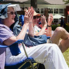 April and Frank Brown clap as the Chautauqua Community Band finishes playing a tune at the group's 25th Annual Independence Day Concert at 12:15 PM on July 4, 2016, on Bestor Plaza. The Browns were one of the many Chautauquan couples who came out to Bestor Plaza to enjoy the concert.<br /> <br /> Photo by Carolyn Brown.