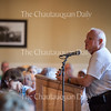 Bill Neches, president of the Chautauquan Property Owners Association, welcomes attendees to the Chautauqua Property Owners Association Potluck in the Athenaeum Hotel on June 22, 2016. The potluck, which had over 200 attendees, was previously held in the basement of Hurlbut Church. Neches said that the Association decided to host the potluck in the Athenaeum because Hurlbut had not been big enough for the event in recent years. Even in the larger space of the Athenaeum, the dining room was crowded, and many guests went to the porch to find space to enjoy their dinners.