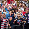 Children sing patriotic songs on the steps of the Colonnade at the conclusion of Children's School's annual Independence Day Parade on July 1, 2016. The parade was held on the Friday before the Fourth of July because the holiday officially falls on a Monday, which would give newcomers to Children's School no time to prepare for the parade. The parade was almost relocated due to rain, but the skies cleared up enough for the children to march to the Colonnade along their traditional parade route. Photo by Carolyn Brown.