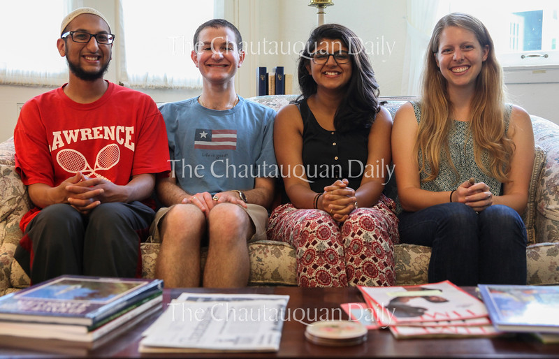 From left: Yasin Ahmed, Muslim correspondent; David Bloom, Jewish correspondent; Safia Lakhani, Muslim correspondent; and Emily Peterson, Christian correspondent, who make up the Abrahamic Program for Young Adults, pose for a picture at 5 PM on July 7, 2016, inside the Methodist House. <br /> <br /> Photo by Carolyn Brown.