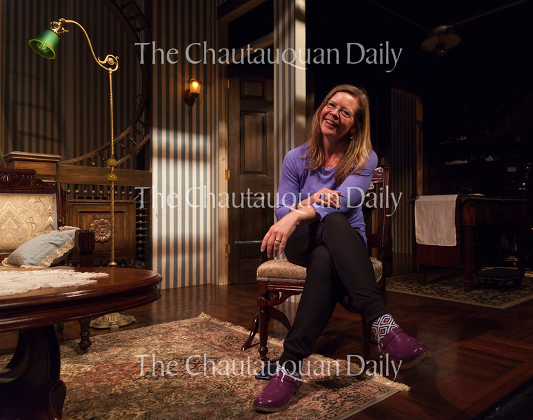 "Larissa Kokernot, director of the Chautauqua Theater Company's upcoming production of ""In the Next Room (or the vibrator play),"" poses for a photo on the set of the show in Bratton Theater on June 29, 2016. ""In the Next Room (or the vibrator play)"" will run at Bratton Theater from July 1 through July 10. Photo by Carolyn Brown."