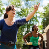 """Actors Kathryn Metzger, left, and Adrianna Mitchell, right, perform in a dramatization of Daniel Manus Pinkwater's book """"The Big Orange Splot"""" at the Children's School Open House at 11:35 AM on July 15, 2016, at Children's School. <br /> <br /> In addition to the performance, the Children's School Open House also featured children doing crafts and skits in their classrooms, a silent auction, and a show in which children sang three songs for their parents. Photo by Carolyn Brown."""