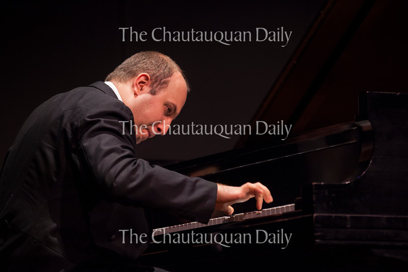 """Pianist Alexander Gavrylyuk performs  Prokofiev's """"Piano Sonata No. 3 in A minor, op. 28"""" in a recital at 8:15 PM on July 20, 2016, in the Amphitheater. Although this was a solo recital, Gavrylyuk will also perform with the Chautauqua Symphony Orchestra at 8:15 PM on July 23, 2016, in the Amphitheater. Photo by Carolyn Brown."""