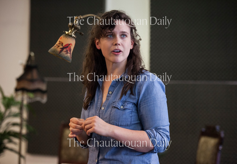 """Actress Kathryn Metzger, as the character Catherine Givings, rehearses a scene from the Chautauqua Theater Company's upcoming production of Sarah Ruhl's """"In the Next Room (or the vibrator play),"""" directed by Larissa Kokernot, in Brawdy Theater Studios on June 25, 2016.<br /> <br /> In the show, Metzger plays a Victorian woman who, with her friend Sabrina Daldry (played by Allison Altman), rediscovers her own sexuality when Dr. Givings, her  husband, introduces her to a mechanism that we know today as a vibrator. In this scene, Givings contemplates the future of electricity.<br /> <br /> Photo by Carolyn Brown."""
