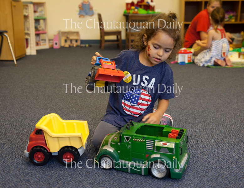 Addy Rodriguez plays with toys in the Red Room at 10 AM on July 1, 2016, at Children's School. Later that morning, Rodriguez marched in the Children's School's annual Independence Day Parade with her classmates. Photo by Carolyn Brown.