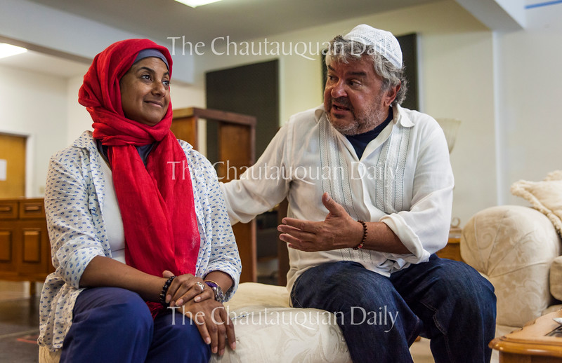 """Rita Wolf, left, and Edward Furs, right, as the characters Carmen and Peter, respectively, rehearse a scene from the Chautauqua Theater Company's upcoming production of Zayd Dohm's """"The Profane."""" The show focuses on the the conflict that arises when a professor's daughter falls in love with the son of Muslim fundamentalists. Photo by Carolyn Brown."""