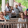 "Atteendees listen during a Chautauqua Institution Trustees Porch Discussion entitled ""Family & Youth Experiences and Programs"" at 12:30 PM on July 22, 2016, on the porch of Hultquist Center. <br /> <br /> At the event, Sherra Babcock, vice president and Emily and Richard Smucker Chair for Education, and Matt Ewalt, associate director of education and youth services, talked about the work that they do to enhance young Chautauquans' summer experiences with community programming and other outreach efforts. Photo by Carolyn Brown."