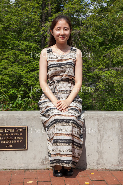 Xiaoya Liu poses for a photo on the Piano Lovers Patio on Tuesday, July 26, 2016, outside Sherwood-Marsh Studios. Liu was one of six preliminary finalists in the Annual Piano Competition in the Piano Program at Chautauqua. Photo by Carolyn Brown.