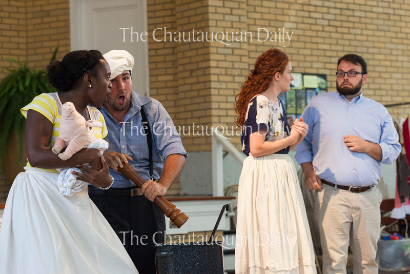 "From left: mezzo-soprano Tesia Kwarteng, tenor Anthony Ciaramitaro, soprano Margaret Bridge, and baritone Jake Skipworth perform ""Pig and Pepper"" from Susan Botti's opera ""Wonderglass"" at the Chautauqua Opera's event ""Hojo-To-Jo! To the Opera We Go!"" at 5 PM on July 19, 2016, at Smith Wilkes Hall.<br /> <br /> <br /> ""Wonderglass"" is an opera based on the works of Lewis Carroll. Photo by Carolyn Brown."