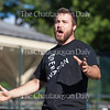 """Baritone Heath Martin sings the aria """"Love, I'm Here on a Mission"""" from """"Cold Sassy Tree"""" by Carlisle Floyd at Opera Open Book 1, the first in the Chautauqua Opera's Opera Invasion series, at 6:15 PM on July 1, 2016 in front of the Amphitheater.<br /> <br /> Martin alternated performing with soprano Laura Soto-Bayomi and mezzo-soprano Kelly Clarke, who sang arias from """"Roméo et Juilette,"""" """"Carmen,"""" and """"The Rape of Lucretia.""""<br /> <br /> Photo by Carolyn Brown."""