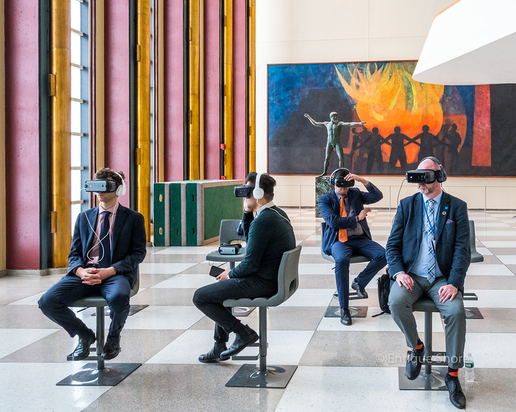 Ocean Conference delegates watch environmental messages using VR goggles at United Nations headquarters