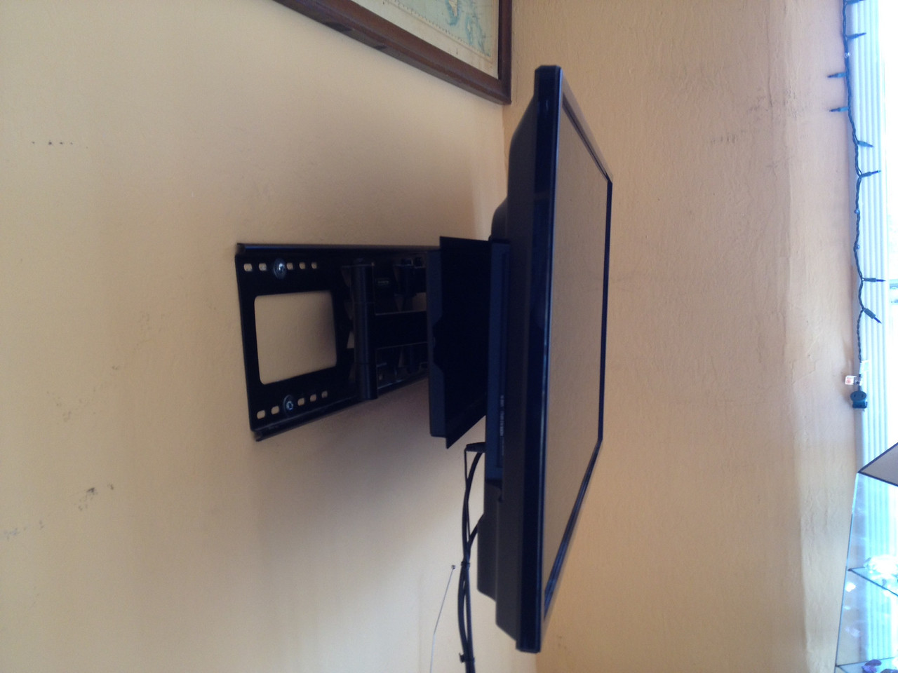 Television mount.  Can be flush for storage and angle toward viewer when in use.