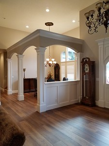 View of the Formal Dining area columns and 1/2 wall