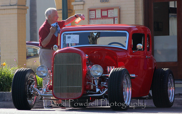 Bill Neumann sprucing up the car prior the start of the event.