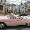 Classic car in front of collapsed building near John Lennon Park, Havana