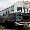 Abandoned school bus with caution sign on Cat Island, Bahama