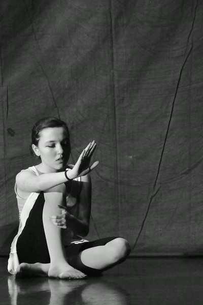 Photograph<br /> The most powerful student dancer I have ever seen.<br /> In a piece about bullying, this girl was able to express in one pose so many emotions that come when someone is the victim of a bully-  the most powerful in this photo to me is a subtle strength in the grip of her hand and the line of her leg and back.