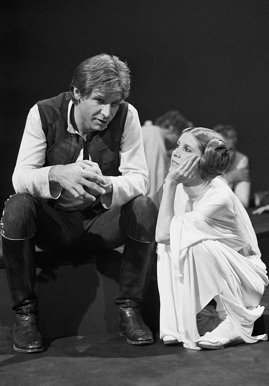 ". FILE - In this Nov. 13, 1978 file photo, Harrison Ford talks with Carrie Fisher during a break in the filming of the CBS-TV special ""The Star Wars Holiday\"" in Los Angeles. On Tuesday, Dec. 27, 2016, a publicist says Fisher has died at the age of 60. (AP Photo/George Brich, File)"