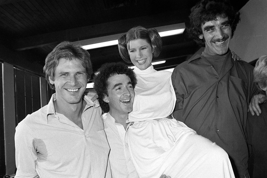 . FILE - In this Oct. 5, 1978 photo, from left, actors Harrison Ford, Anthony Daniels, Carrie Fisher and Peter Mayhew take a break from filming a television special in Los Angeles to be telecast during the holidays. On Tuesday, Dec. 27, 2016, a publicist says Fisher has died at the age of 60. (AP Photo/George Brich, File)