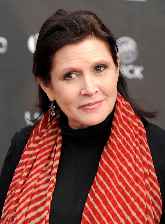 . FILE - In this Thursday, April 7, 2011 file photo, Carrie Fisher arrives at the 2011 NewNowNext Awards in Los Angeles. On Tuesday, Dec. 27, 2016, a publicist said Fisher has died at the age of 60. (AP Photo/Chris Pizzello, File)