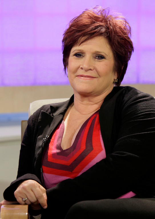 ". FILE - In this Tuesday, Sept. 29, 2009 file photo, actress and writer Carrie Fisher appears on the NBC ""Today\"" television program in New York to discuss \""Wishful Drinking,\"" her autobiographical solo show on Broadway. On Tuesday, Dec. 27, 2016, a publicist said Fisher has died at the age of 60. (AP Photo/Richard Drew, File)"