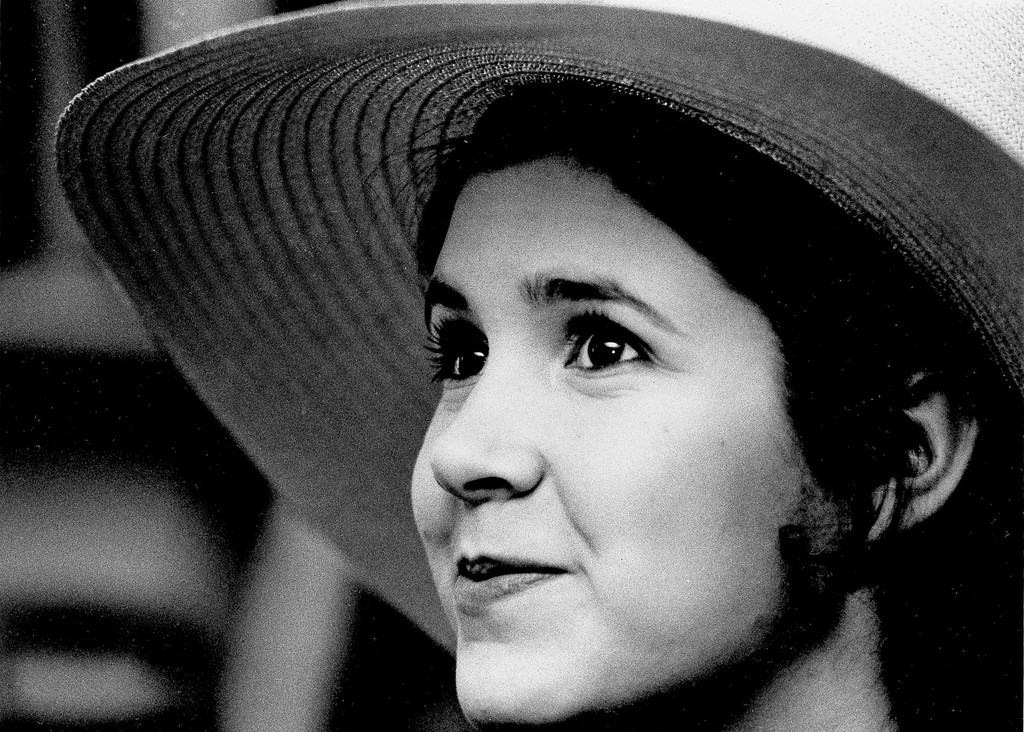 . FILE - This May 2, 1973 file photo shows Carrie Fisher, the 16-year-old daughter of Debbie Reynolds and Eddie Fisher, in New York. On Tuesday, Dec. 27, 2016, a publicist says Carrie Fisher has died at the age of 60. (AP Photo/Jerry Mosey, File)
