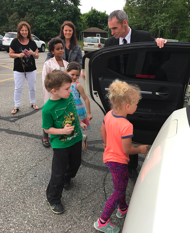 . photo by Lisa Yanick Litwiller  Six of the 250 students at Carrie Knause Early Learning Center achieved perfect attendance this year; they were rewarded with a limo ride and a pizza lunch.