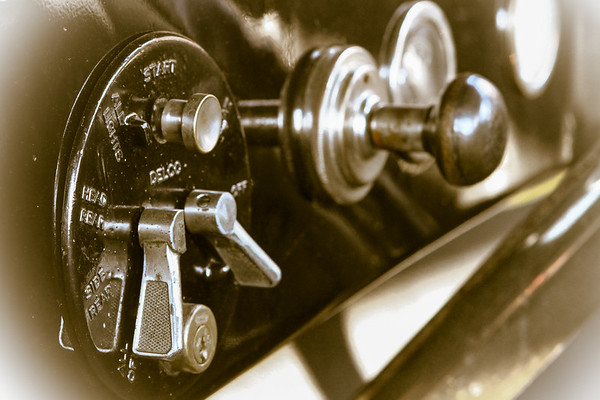 close-up of the dash switches of a old car