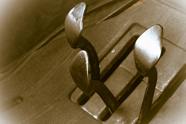peddles on old floorboard in a old car