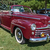 1947 Ford Super DeLuxe Eight convertible, 2011 Greenfield Village Motor Muster; color is Monsoon Maroon; for 1947 & '48 parking lamps below headlights replaced 1942-'46 rectangular units above grille, & grille bars lost red-paint accent stripes; color selection same in '47 & '48 (see '48 coupe in Pheasant Red)