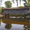 Ackley Covered Bridge in Greenfield Village, Dearborn, MI, since 1937; blt 1832 in Washington County, PA; 75-ft span, variation of Burr truss; crosses small lagoon btwn RR track & Burbank house