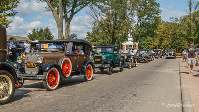 2011 Greenfield Village Old Car Festival; cars of 1929 lined up on Post Road, SE side of Village Green, with Martha-Mary Chapel in background; built 1929 at NE end of Village Green, it is one of six non-denominational chapels Henry Ford built across US in honor of his wife's mother (Martha Bryant) and his mother (Mary Litigot Ford)