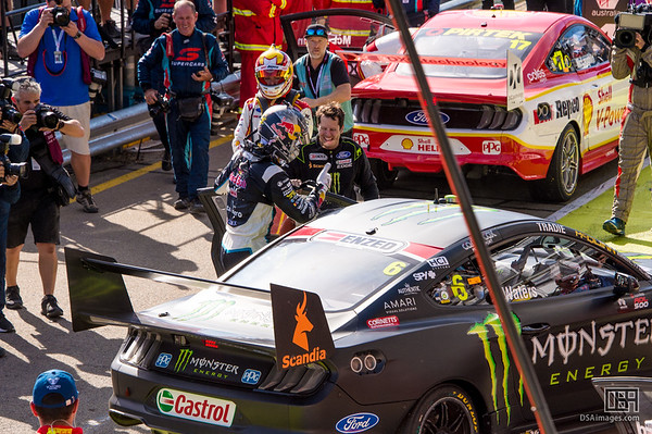 Shane van Gisbergen gets a lift to the pits with Cameron Waters