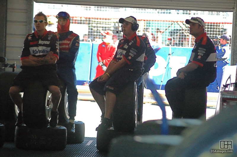 One of the race teams make use of the available seating to watch the race.