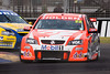 Todd Kelly, of the Holden Racing Team, closely followed by James Courtney, of the Stone Brothers Racing Team