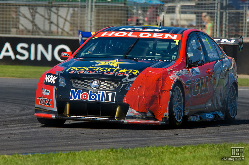 James Courtney of the Toll Holden Racing Team, with some running repairs