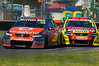 Jamie Whincup, of TeamVodafone, ahead of Russell Ingall, of the Supercheap Auto Racing team