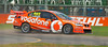 Craig Lowndes of TeamVodafone, sliding off onto the grass