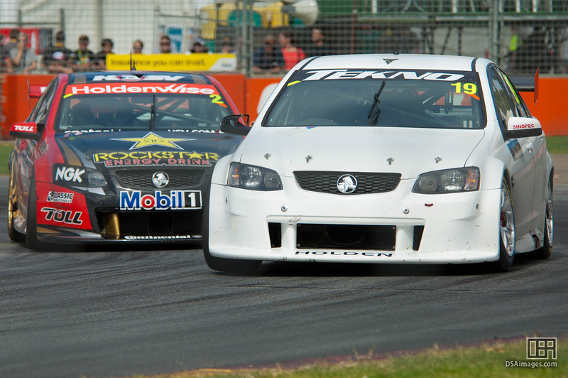 Jonathon Webb of Tekno Autosport with Garth Tander close behind