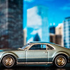 A Johnny Lightning 1:64 model of a 1967 Olds Toronado positioned in front of my iPad with a photo I took of some buildings in Chicago. My very first car was a 1966 Olds Toronado. My second car was a 1978 Honda Civic. I went from a large, 6-passenger car to a tiny little car that would barely hold 4 people ;-)