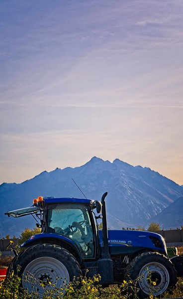 Blue tractor, blue mountain, blue sky