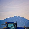 Blue tractor, blue mountain, blue sky
