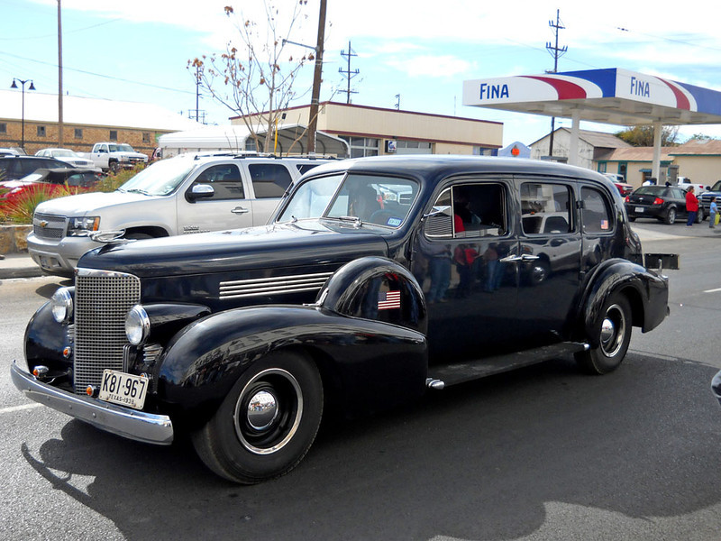 1938 CADILLAC<br /> Now here's a beauty for you. The owner said it's actually painted dark midnight blue with black fenders, but it looks all balck to me. It's a sweet ride no matter what the color.
