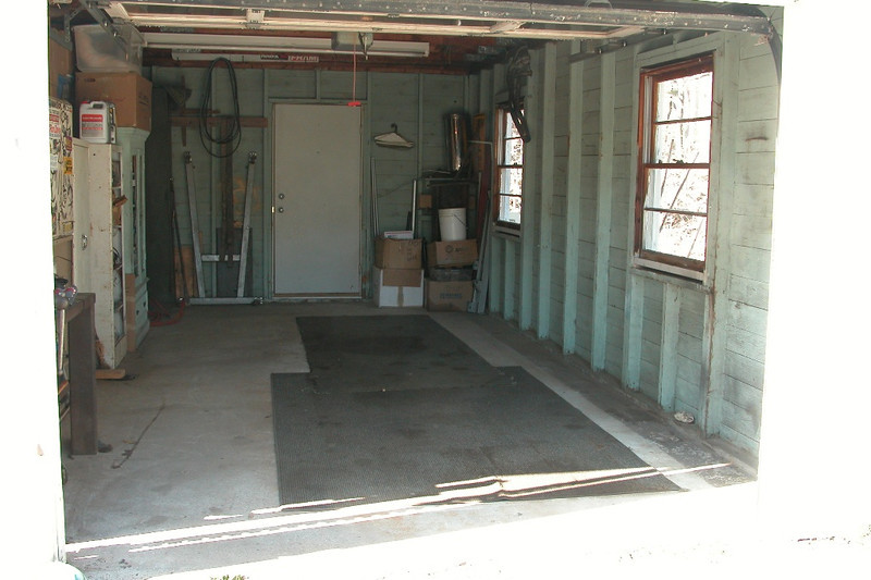 Open garage.  I use the junk rubber backed carpet to protect the floor.