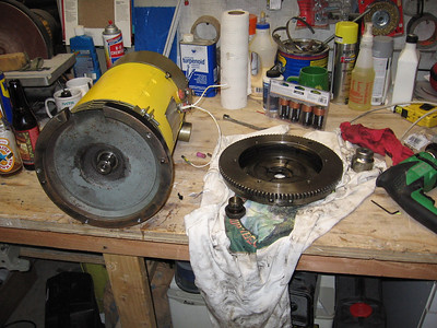 Here is a picture of the motor on the left and the VW flywheel on the right. The shaft of the motor must align with the inner diameter of the flywheel.