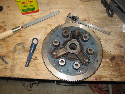 The clutch plate and clutch pad mounted to the fly wheel.